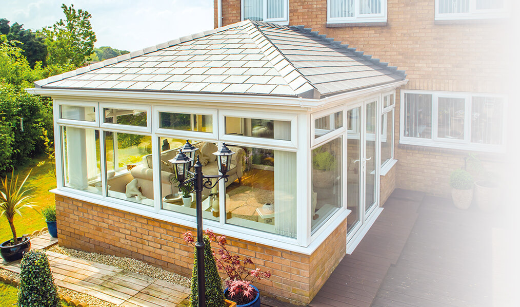 Edwardian conservatory with a grey Supalite tiled roof