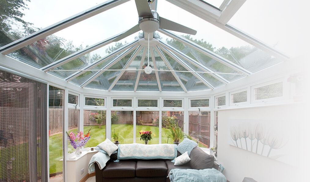 uPVC Victorian conservatory with a glass roof